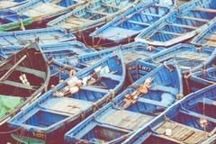 Удить голубые шлюпки в Marocco Серии голубых рыбацких лодок в Стоковая Фотография RF
