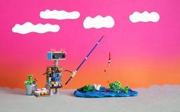Удить робототехнический и каникулы Робот рыболова хочет улавливать большую рыбу Приманка ведра штанги аксессуаров рыболова o стоковое фото rf