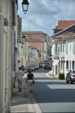 Узкая улица в французском городке Стоковая Фотография RF