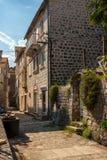 Узкая улица древнего города Perast, Черногории Стоковые Фотографии RF