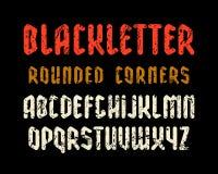 Узкий шрифт sanserif в стиле черной буквы с округленными углами Стоковая Фотография RF
