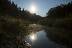 Узкое река на зоре Стоковые Фотографии RF