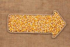 Указатель сделанный от веревочки при мозоль зерна лежа на дерюге Стоковые Изображения RF