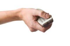 Укомплектовывает личным составом руку с remote tv Стоковые Изображения RF