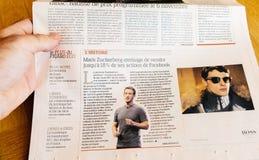 Укомплектуйте личным составом намерение главного исполнительного директора Zuckerberg Facebook газеты чтения продать Стоковые Фото