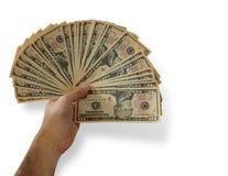 Укомплектуйте личным составом руку ` s держа группу в составе 10 долларовых банкнот в форме вентилятора на белой предпосылке Стоковые Изображения