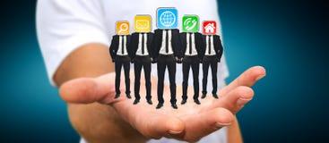 Укомплектуйте личным составом держать группу в составе бизнесмены в его руке с применением ic Стоковое Изображение RF