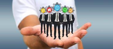 Укомплектуйте личным составом держать группу в составе бизнесмены в его руке с применением ic Стоковые Фотографии RF