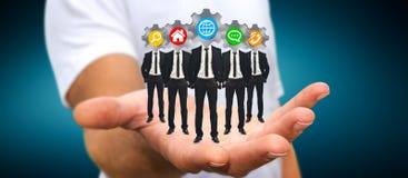 Укомплектуйте личным составом держать группу в составе бизнесмены в его руке с применением ic Стоковые Изображения RF