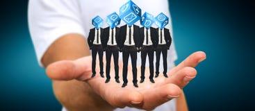Укомплектуйте личным составом держать группу в составе бизнесмены в его руке с применением ic Стоковые Изображения