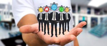 Укомплектуйте личным составом держать группу в составе бизнесмены в его руке с применением ic Стоковое фото RF