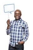 Человек держа усмехаться знака пузыря речи Стоковые Изображения