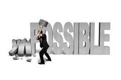 Укомплектуйте личным составом держать молоток для того чтобы треснуть невозможное слово бетона 3D Стоковые Изображения RF