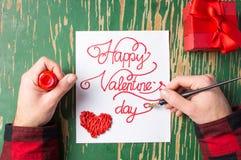 Укомплектуйте личным составом запись карточки дня валентинок и подготавливать настоящий момент Стоковая Фотография