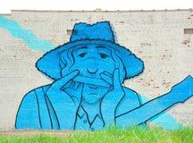 Укомплектуйте личным составом играть настенную роспись губной гармоники в Мемфисе, Теннесси Стоковые Изображения