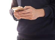 Укомплектуйте личным составом используя золото iPhone 6 Стоковое Изображение