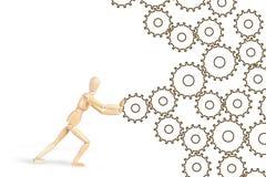 Укомплектуйте личным составом нажатие cogwheels для того чтобы сделать деятельность механизма Стоковое Изображение RF