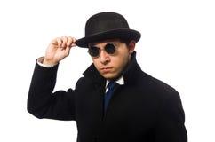 Укомплектуйте личным составом нося черное пальто изолированное на белизне Стоковые Фото