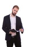 Укомплектуйте личным составом положение при тетрадь, изолированная на белой предпосылке Стоковое Изображение RF