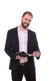 Укомплектуйте личным составом положение при тетрадь, изолированная на белой предпосылке Стоковые Фото
