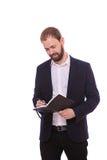 Укомплектуйте личным составом положение при тетрадь, изолированная на белой предпосылке стоковое фото