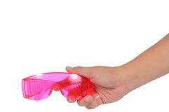 Укомплектуйте личным составом руку держа розовое isola предохранения от защитного стекла ультрафиолетов Стоковое Фото