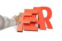 Укомплектуйте личным составом руку нажимая домино красный падать слова страха Стоковое Изображение RF