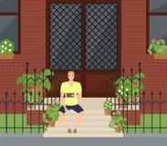 Укомплектуйте личным составом сидеть с таблеткой на лестницах около парадного входа Стоковое Изображение RF