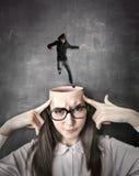Укомплектуйте личным составом скакать в голову девушки Стоковые Изображения RF
