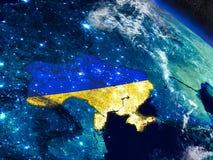 Украина с врезанным флагом от космоса иллюстрация вектора