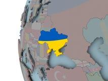 Украина с флагом на глобусе иллюстрация вектора