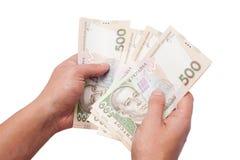 Украинские деньги в руке стоковая фотография rf