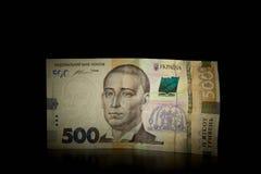 Украинские деньги Новое hryvnia 500 на черной предпосылке Стоковое Изображение