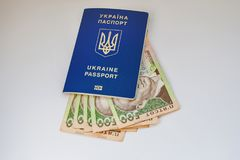 Украинские пасспорт и банкноты стоковое фото rf