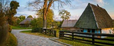 Украинские традиционные дома в деревне на осени Стоковая Фотография