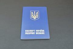 Украинский пасспорт на черной предпосылке Стоковая Фотография