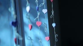Украшение окна Сердца соединенные с веревочкой сток-видео