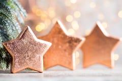 Украшение рождества бронзовое Бронза украшений праздника на bokeh Стоковое Фото
