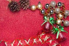 Украшение рождества на красной предпосылке Стоковое фото RF