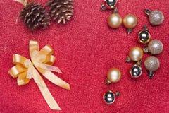 Украшение рождества на красной предпосылке Стоковое Фото