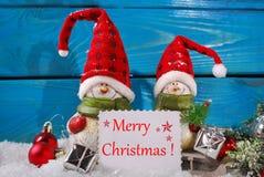 Украшение рождества с figurines santa на деревянной предпосылке Стоковые Изображения RF