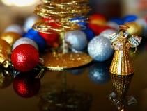 Украшение рождества - шарики с ангелом и деревом Стоковая Фотография