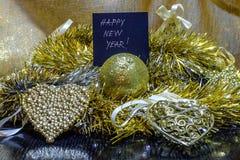 Украшение ` s Нового Года золотое на черной предпосылке Стоковые Изображения