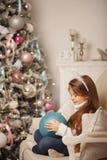 Украшения девушки и рождества Стоковая Фотография