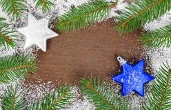 Украшения ели и рождества на деревянной предпосылке Стоковые Фото