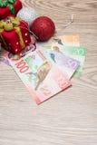 Украшения и деньги рождества Стоковые Фото