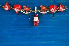 Украшения рождества и света рождества на голубой деревянной предпосылке Стоковые Фото