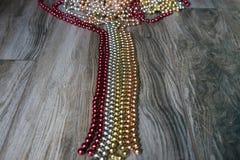 Украшения рождества красного цвета, серебра и золота на поле Стоковые Изображения