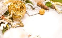 Украшения рождества на белой предпосылке Стоковые Изображения