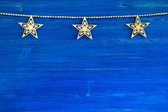 Украшения рождества на голубой деревянной предпосылке Стоковая Фотография RF